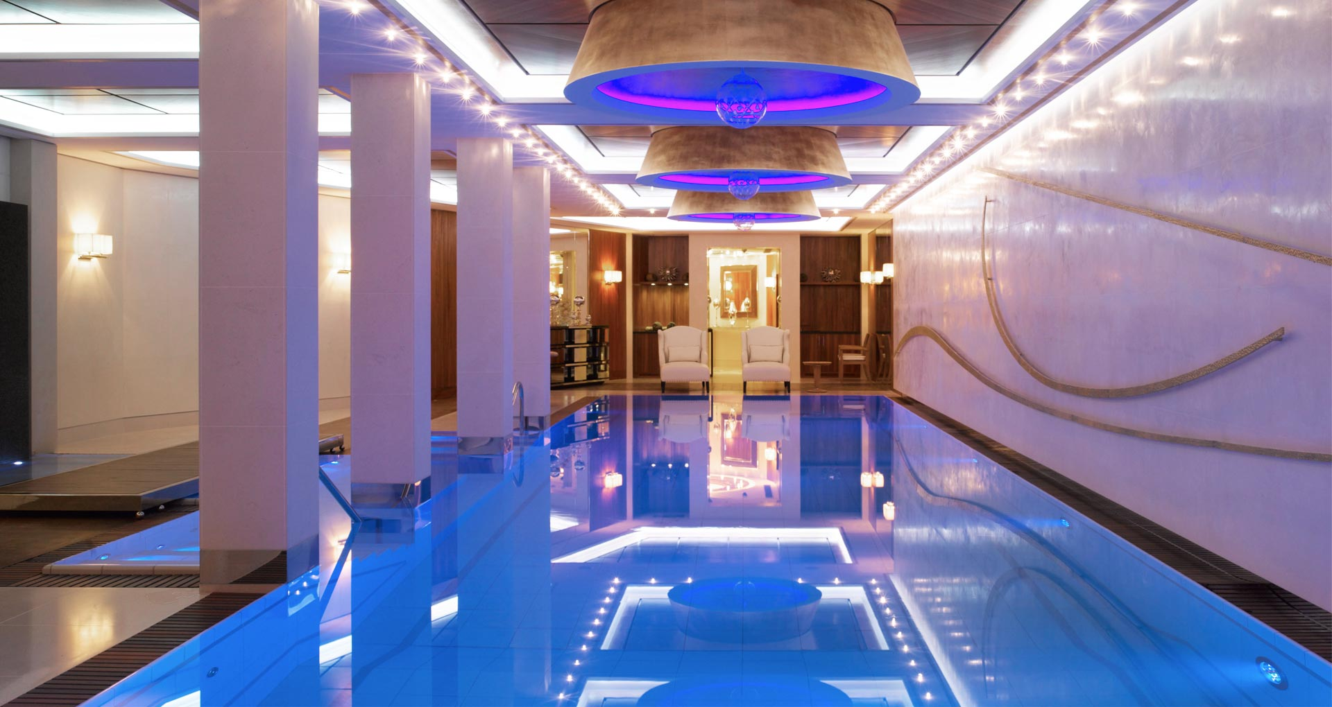 - London, UK  -  Town House  -  An impressive pool within a basement spa complex of a grand private residence