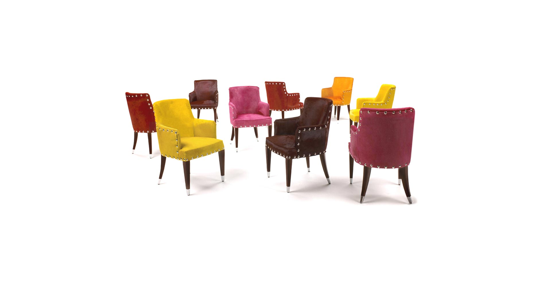 'Fiorenza' armchairs in mahogany shown with pony skin upholstery in various colours. Dimensions (cm): 60(width) x 51(depth) x 97(height)